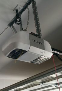 Garage door belt opener